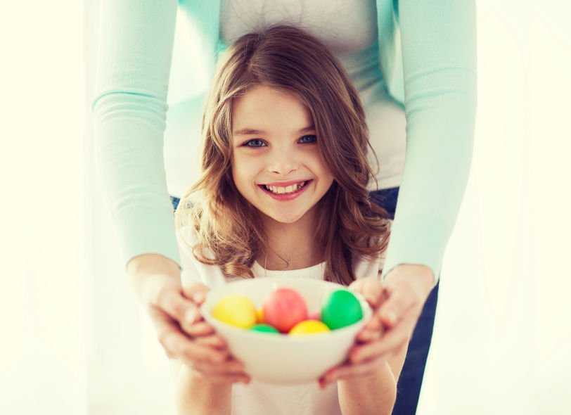 37053973 - easter, family, holiday and child concept - smiling little girl and mother holding bowl with colored eggs